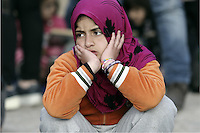 Pictured: A young girl sits down at the port in desperation Friday 26 February 2016<br /> Re: Hundreds of refugees that crossed the border from Turkey to the Greek islands, have arrived at the port of Piraeus near Athens, Greece
