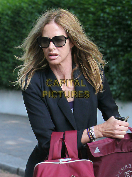 TRINNY WOODALL .pictured in London, England, UK, .May 3rd 2011..half length sunglasses lips plastic cosmetic surgery black blazer jacket .CAP/HIL.©John Hillcoat/Capital Pictures