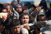 Crush of people at the border.Tens of thousands of people, mainly Egyptian workers, fled unrest in Libya and crossed the border into Tunisia. Some slept in the open for several days before being processed.  At the same time forces loyal to Col. Gaddafi fought opposition forces in various parts of the country.