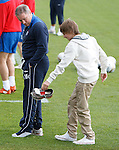 Ally McCoist loses his trainer in the boggy ground and his son retrieves it and shakes out the water