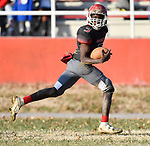 Roosevelt quarterback Alonzo Smith turns and looks back as he runs in the go-ahead touchdown late in the game. Roosevelt defeated Borgia in a Class 3 District 2 football game at Roosevelt HS in St. Louis on Saturday November 16, 2019. <br /> Tim Vizer/Special to STLhighschoolsports.com
