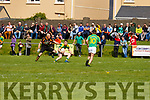 South Kerry's Mark Griffin in possession trying to clear his lines has Kieran Donaghy from Austin Stacks on his back.