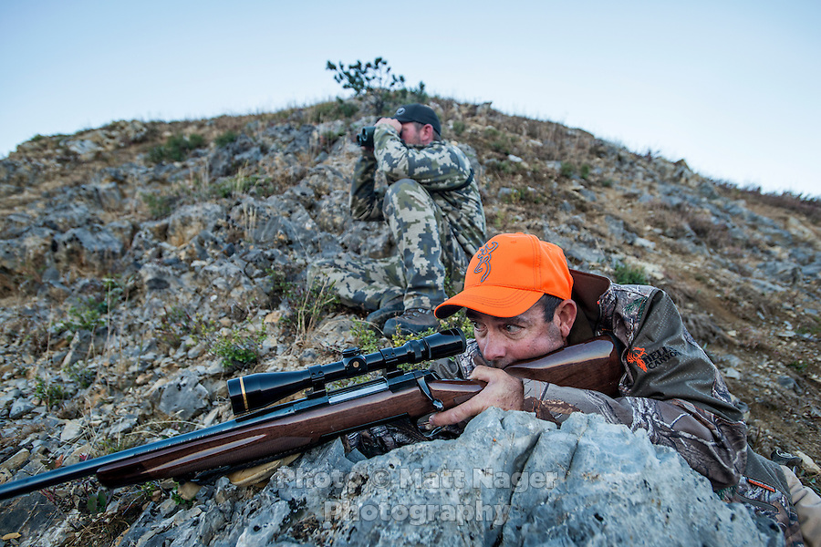 Outdoor Life Editor Andrew McKean looks through his scope after shooting a mule deer while guide Greg Kriese with Trefren Outfitters keeps sight on Greyback Ridge in the Hoeback Drainage of Wyoming Region H, outside of Alpine, Wyoming, Monday, September 21, 2015. <br /> <br /> Photo by Matt Nager