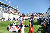 Jordan Spieth (USA) gives a thumbs up to Justin Thomas (USA) on the first tee and the crowd as he walks to the driving range to warm up during round 4 Singles of the 2017 President's Cup, Liberty National Golf Club, Jersey City, New Jersey, USA. 10/1/2017. <br /> Picture: Golffile | Ken Murray<br /> <br /> All photo usage must carry mandatory copyright credit (&copy; Golffile | Ken Murray)
