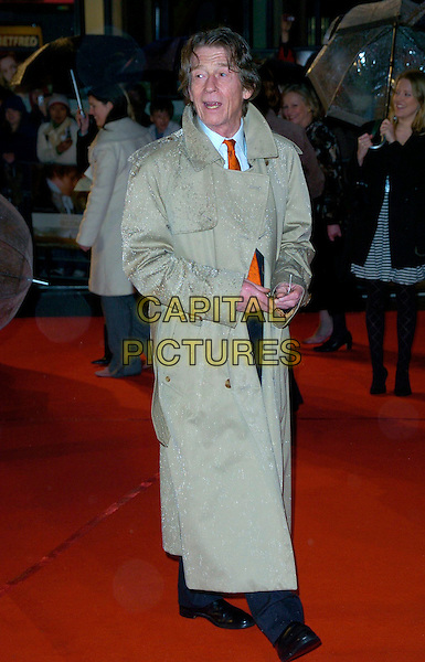 "JOHN HURT.""Becoming Jane"" World Premiere, Odeon West End, .London, England, March 4th 2007..full length beige trench coat mac.CAP/CAN.©Can Nguyen/Capital Pictures"