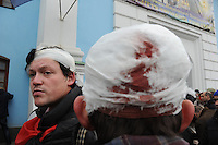Injuried protesters seen after violent assault on main square, Kiev.  People that have been dispersed regather in the nearby Mykhailiv monastery to continue the  protest.