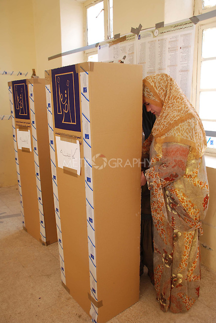KIRKUK, IRAQ:  A woman votes in Kirkuk...On March 7th, 2010 Iraq held national parliamentary elections...Photo by Hawre Khalid/Metrography