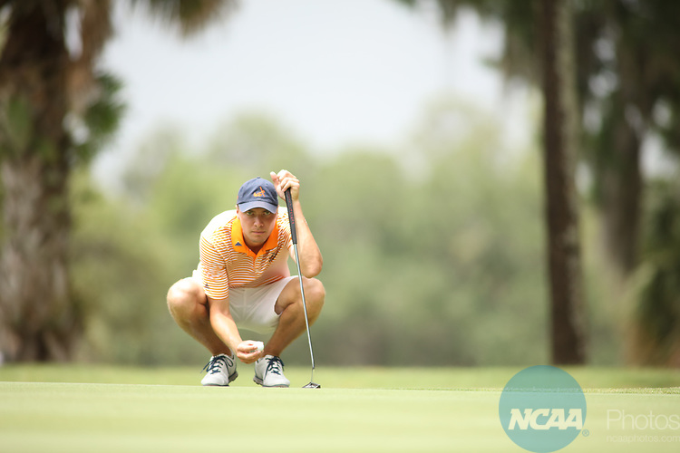 HOWEY IN THE HILLS, FL - MAY 19: Winton Munch of Hope College looks at his putt during the Division III Men's Golf Championship held at the Mission Inn Resort and Club on May 19, 2017 in Howey In The Hills, Florida. (Photo by Cy Cyr/NCAA Photos via Getty Images)