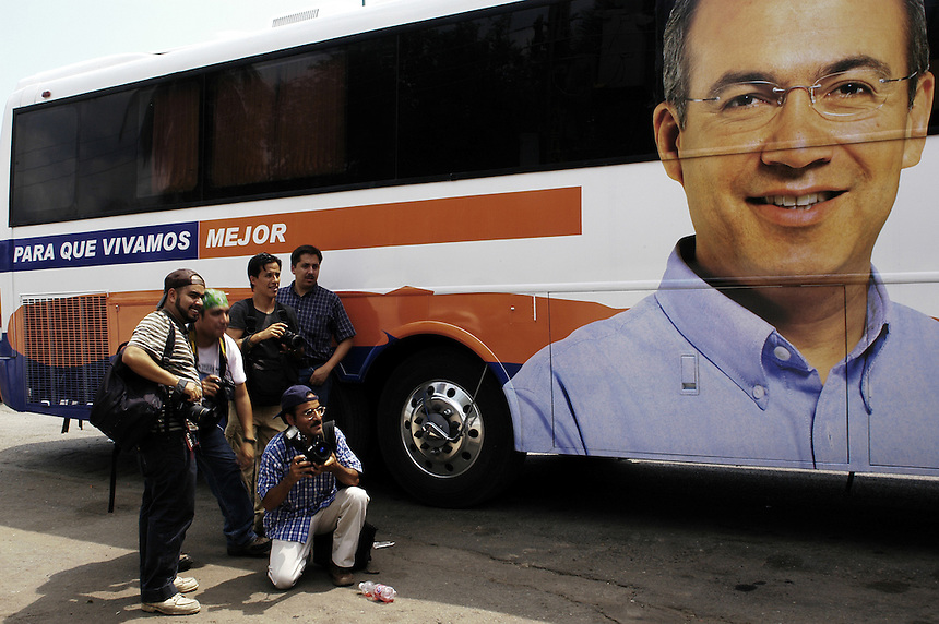The press wait for Felipe Calderon to emerge from his campaign bus for a quick press confrence on the side of the road on his way to Tonala, Chiapas.  Calderon is surging ahead for the presidential race as the nominee of the PAN.