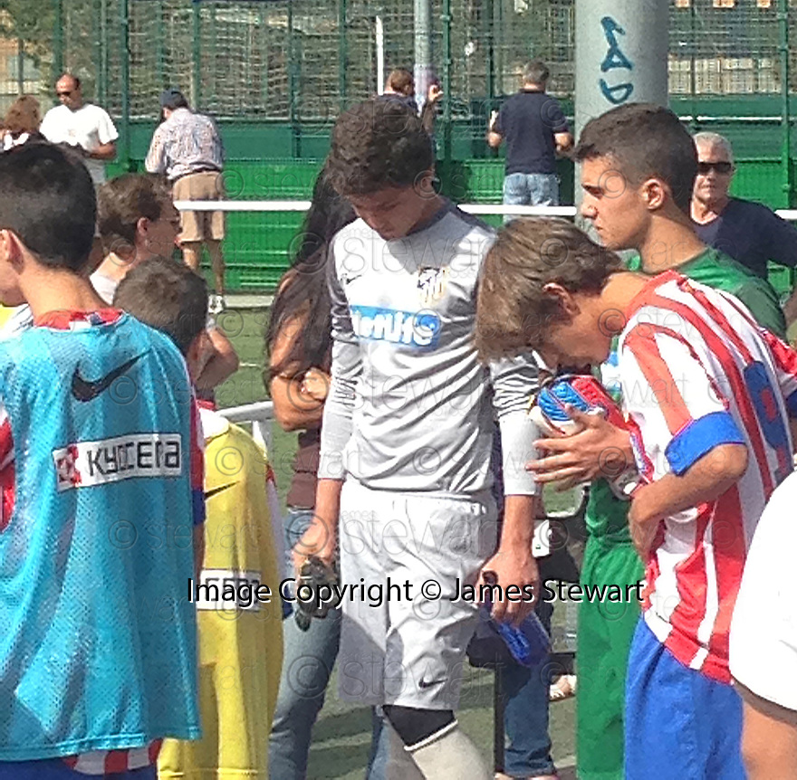 "Collect pic of Josuha Rae, who is 6' 1"" despite only being 12 years old (white top), before he plays one of his games during his trial with Atletico de Madrid.."