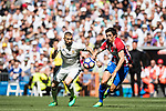 Karim Benzema (l) of Real Madrid battles for the ball with Stefan Savic of Atletico de Madrid during their La Liga match between Real Madrid and Atletico de Madrid at the Santiago Bernabeu Stadium on 08 April 2017 in Madrid, Spain. Photo by Diego Gonzalez Souto / Power Sport Images