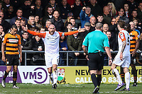 Scott Cuthbert of Luton Town (2nd left) contests a decision by Referee, Mt Graham Salisbury (3rd left) during the Sky Bet League 2 match between Barnet and Luton Town at The Hive, London, England on 28 March 2016. Photo by David Horn.