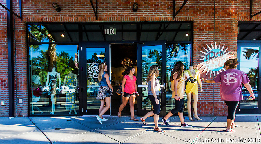 Shoppers ebb and flow at the Reef Boutique in Tallahassee's College Town area.<br /> <br /> COLIN HACKLEY PHOTO