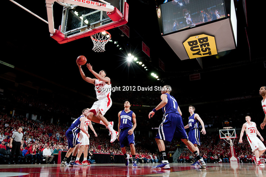 Wisconsin Badgers forward Ryan Evans (5) shoots a layup against the Northwestern Wildcats during a Big Ten Conference NCAA college basketball game on January 18, 2012 in Madison, Wisconsin. The Badgers won 77-57. (Photo by David Stluka)