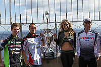 "New York, USA. 23 April 2014.  Supercross motorcycle racers (L-R) Adam Cianciarulo, Mike Alessi, ""Miss Supercross"" Dianna Dahlgren, Chad Reed promote their motorcycle race during a visit to the Empire State Building in New York. Photo by Eduardo Munoz Alvarez/VIEWpress"