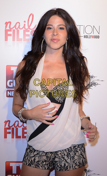 "Jen Tapiero.Season 2 Premiere Party of TV Guide Network's ""Nail Files"" held at Station Hollywood at W Hotel, Los Angeles, California, USA..August 19th, 2012.half length embellished silver bra black lace shorts wrap top beige hand arm.CAP/ADM/TW.©Tonya Wise/AdMedia/Capital Pictures."