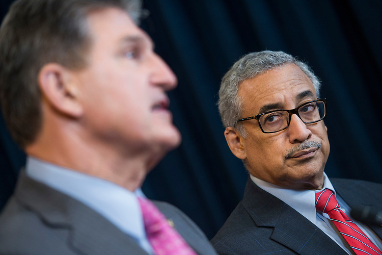"UNITED STATES - APRIL 5: Reps. Bobby Scott, D-Va., right, and Sen. Joe Manchin, D-W.Va., conduct a news conference in the Capitol Visitor Center to introduce miner's health care legislation the ""Black Lung Benefits Improvement Act of 2017"" and the ""Robert C. Byrd Mine Safety Protection Act of 2017,"" April 5, 2017. Sen. Bob Casey, D-Pa., and Rep. Matt Cartwright, D-Pa., also attended. (Photo By Tom Williams/CQ Roll Call)"