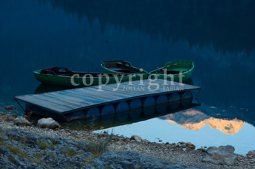 Three green wooden boats in the Black Lake, near to Zabljak in the Durmitor National Park, Montenergo, Europe. Durmitor is a national park since 1952, protected by UNESCO since 1977, and World Heritage Site since 1980