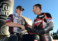 Nov. 10, 2012; Pomona, CA, USA: NHRA pro stock motorcycle rider Eddie Krawiec (right) celebrates with team owner Byron Hines after clinching the 2012 world championship during qualifying for the Auto Club Finals at at Auto Club Raceway at Pomona. Mandatory Credit: Mark J. Rebilas-