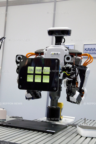 October 17, 2012, Tokyo, Japan - A robot constructs an electronic announce at Japan Robot Week. The Japan Robot Week 2012 shows the New Energy and Industrial Robot Innovation Technology products in Japan, the exhibition opens from October 17 to 19 at Tokyo Big Sight. (Photo by Rodrigo Reyes Marin/AFLO)..