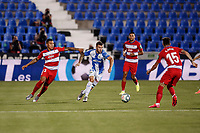 22nd June 2020; Estadio Municipal de Butarque, Madrid, Spain; La Liga Football, Club Deportivo Leganes versus Granada; Aitor Ruibal (CD Leganes)  breaks forward as Neva of Granada comes in to challlenge