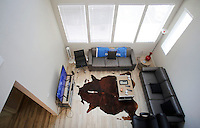 NWA Democrat-Gazette/DAVID GOTTSCHALK  A portion of the downstairs living area of a four bedroom apartment at Beechwood Village Wednesday, August 26, 2015 in Fayetteville. The new apartment complex is aimed at University of Arkansas students and opened Saturday offering 12 different floor plans.