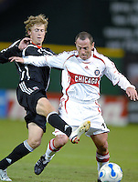 Chicago Fire midfielder Pascal Bedrossian (13) tries to hold off DC United midfielder Brian Carroll (16). The Chicago Fire defeated DC United 3-2, Sunday, October 15, 2006, at RFK Stadium.
