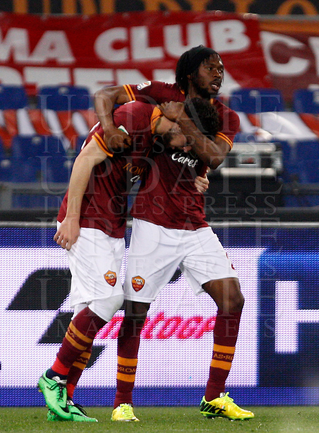 Calcio, Serie A: Roma vs Udinese. Roma, stadio Olimpico, 17 marzo 2014.<br /> AS Roma forward Mattia Destro, left, celebrates with teammate Gervinho, of Ivory Coast, after scoring during the Italian Serie A football match between AS Roma and Udinese at Rome's Olympic stadium, 17 March 2014.<br /> UPDATE IMAGES PRESS/Riccardo De Luca