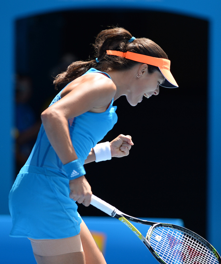 Ana Ivanovic (SRB) [14] in action during her victory over Serena Williams (USA) [1] in their Women's Singles Fourth Round match today - Ana Ivanovic (SRB) [14] def Serena Williams (USA) [1] 4-6 6-3 6-3<br /> <br /> Photo by Gillian Elliott/CameraSport<br /> <br /> International Tennis - Australian Open - Day 7 Sunday 19th January 2014 - Melbourne Park - Melbourne, Victoria, Australia<br /> <br /> &copy; CameraSport - 43 Linden Ave. Countesthorpe. Leicester. England. LE8 5PG - Tel: +44 (0) 116 277 4147 - admin@camerasport.com - www.camerasport.com