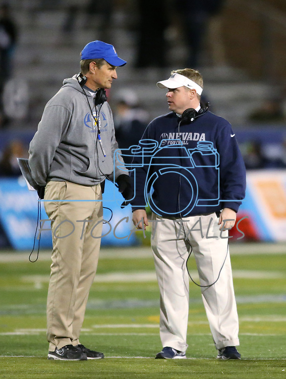 San Jose State's Head Coach Ron Caragher and Nevada's Head Coach Brian Polian talk during an injury timeout in an NCAA college football game in Reno, Nev., on Saturday, Nov. 16, 2013. (AP Photo/Cathleen Allison)