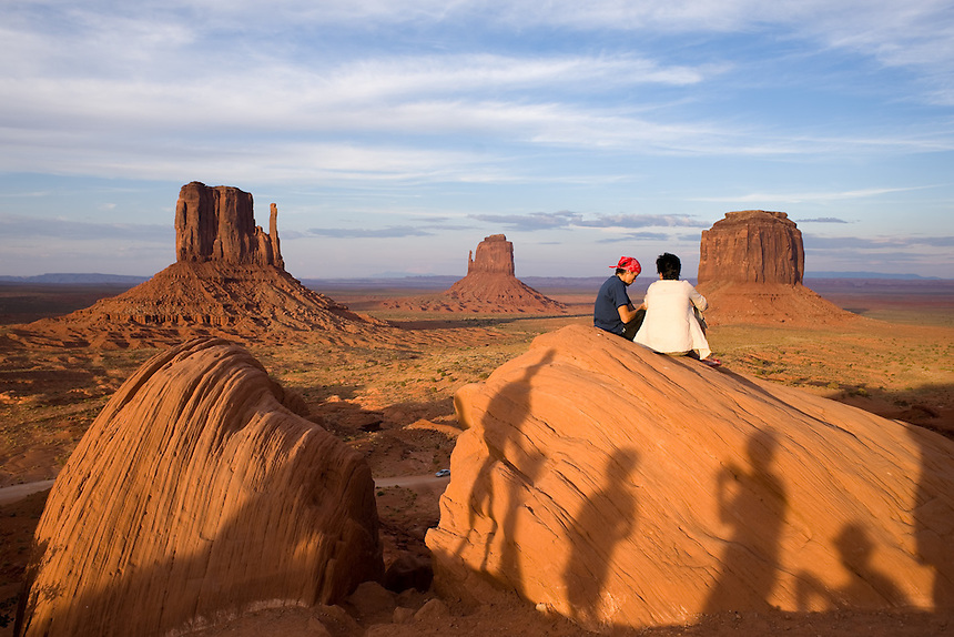 Tourists climb atop rocks photographed by Ansel Adams at Monument Valley Navajo Tribal Park in southern Utah. The park, operated by teh tribe, was once a popular set for western films of the 1930s through 60s. It is immensely popular among European tourists. (Kevin Moloney for the New York Times)