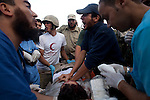Medics performed CPR on a fighter with a bullet wound to the head, near the front line on Dubai Street, where pro-Gaddafi snipers took up positions to target revolutionary fighters in central Sirte, Libya, Oct. 13, 2011. The wounded fighter died a few minutes later. Revolutionary forces solidified control of the pro-Gaddafi stronghold, but fighting continued in a few neighborhoods.