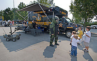 A Franklin County Ohio bomb squad officer talks with a group of kids at the Cops and Kids Day at Hoff Woods Park in Westerville, Ohio.<br />