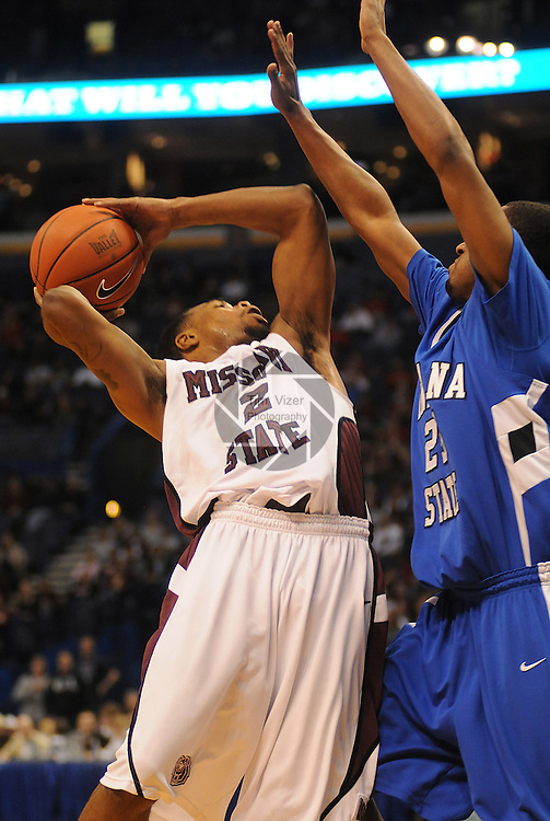 March 5,  2011        Missouri State Bears guard Nafis Ricks (2) shoots as Indiana State Sycamores guard Steve McWhorter (25) blocks in the first half. Indiana State played MIssouri State in the championship game of the NCAA Missouri Valley Conference Men's Basketball Tournament on Sunday March 6, 2011 at the Scottrade Center in downtown St. Louis.  The winner receives an automatic bid to the NCAA Basketball Tournament