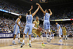 14 March 2015: Notre Dame's Zach Auguste (30) is guarded by North Carolina's Brice Johnson (11), J.P. Tokoto (13) and Kennedy Meeks (left). The Notre Dame Fighting Irish played the University of North Carolina Tar Heels in an NCAA Division I Men's basketball game at the Greensboro Coliseum in Greensboro, North Carolina in the ACC Men's Basketball Tournament quarterfinal game. Notre Dame won the game 90-82.