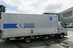 A Sagawa Express delivery truck arrives at Sagawa headquarters on July 28, 2017, Tokyo, Japan. Sagawa Express Co. expects to increase its delivery charges from November 21st due to the increasing demand from online shopping. The company said on Wednesday that its door to door service fee would rise 17.8 percent on average. Competitor Yamato Transport Co. also plans to raise rates in October. (Photo by Rodrigo Reyes Marin/AFLO)