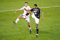 Greg Davis (14) of the Providence Friars plays the ball in front of Alex Hadley (23) of the Cincinnati Bearcats. The Providence Friars defeated the Cincinnati Bearcats 2-1 during the semi-finals of the Big East Men's Soccer Championship at Red Bull Arena in Harrison, NJ, on November 12, 2010.
