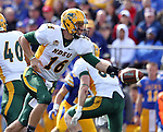 BROOKINGS, SD - SEPTEMBER 28:  Brock Jensen #16 from North Dakota State University hands the ball off against South Dakota State University in the first quarter of their game Saturday afternoon at Coughlin Alumni Stadium in Brookings. (Photo by Dave Eggen/Inertia)