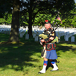Aug. 18, 2012 - Farmingdale, New York, U.S.: The Lone Piper, following tradition, plays bagpipes as he walks through rows of soldiers' tombstones at the end of burial ceremony of Marine Lance Corporal Greg Buckley Jr, 21 - the Oceanside native killed in Afghanistan 9 days earlier - at Long Island National Cemetery.