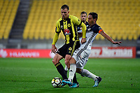 Wellington Phoenix&rsquo; Daniel Mullen and Melbourne Victory&rsquo;s Mark Milligan in action during the A League - Wellington Phoenix v Melbourne Victory FC at Westpac Stadium, Wellington, New Zealand on Wednesday 10 January 2018. <br /> Photo by Masanori Udagawa. <br /> www.photowellington.photoshelter.com