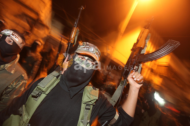 Masked Hamas militants march with their guns during a parade to mark the third anniversary of the Israeli offensive on Gaza in 2008, in Gaza City, Tuesday, Dec. 27, 2011. Palestinians mark the third anniversary of the three-week offensive Israel launched in Gaza in late 2008. Photo by Majdi Fathi