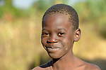 A boy in Jombo, Malawi. With assistance from the AIDS program of the Livingstonia Synod of the Church of Central Africa Presbyterian, a sexual and reproductive health club for children and youth operates in this village, allowing young people to educate their peers about avoiding HIV transmission, resisting early marriages, and the prevention of early school dropouts.