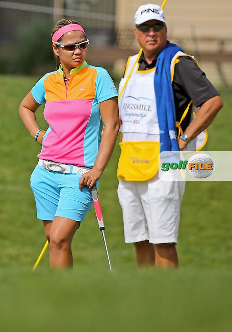 15 MAY 14 Jennifer Rosales with her caddie Matt Gelczes during Thursday's First Round at The KIngsmill Championship at The Kingsmill Resort River Course in Williamsburg, Virginia. (photo credit : kenneth e. dennis/kendennisphoto.com)