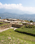 The lower ball court by the East House or Casa de Oriente in the ruins of the Zapotec city of Atzompa, near Oaxaca, Mexico.  In the background is the Central Valley and city of Oaxaca.