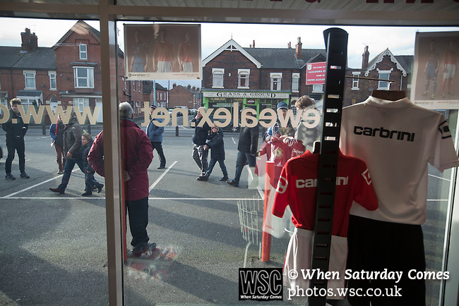 Crewe Alexandra 1 Leyton Orient 2, 18/01/2014. Gresty Road, League One. Supporters walking outside the club shop at the Alexandra Stadium on Gresty Road, Crewe, the home of Crewe Alexandra before their home game against Leyton Orient in the SkyBet League One. The match was won by the visitors from London by 2-1 with two goals on debut by Chris Dagnall, sending Orient to the top of the league. The match was watched by 4830 spectators. Photo by Colin McPherson.