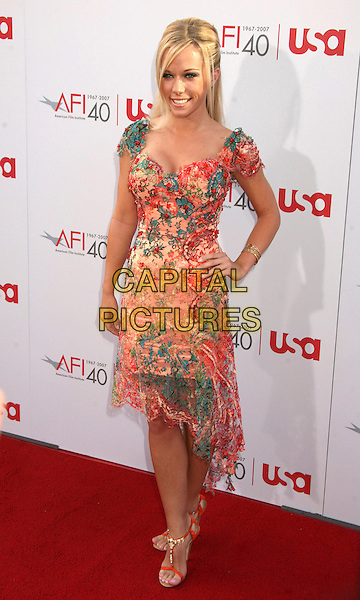 KENDRA WILKINSON.35th Annual AFI Life Achievement Award Honoring Al Pacino at the Kodak Theatre, Hollywood, California, USA.7 June 2007..full length orange patterned floral print dress hand on hip.CAP/ADM/BP.©Byron Purvis/AdMedia/Capital Pictures.