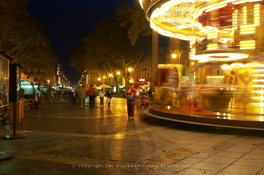 The place de l'Horloge main town square in Avignon at night with a merry-go-round carrousel carousel merry go round. Avignon, Vaucluse, Provence, Alpes Cote d Azur, France, Europe