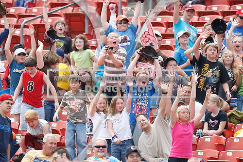 May 28, 2009:  Fans cheer for a souvenir baseball thrown out by staff and mascots during a game at Coca-Cola Field in Buffalo, NY.  Photo by:  Mike Janes/Four Seam Images