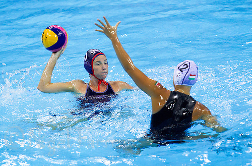 30 JUL 2012 - LONDON, GBR - Kelly Rulon (USA) of USA (left) prepares to pass the ball during the women's London 2012 Olympic Games water polo qualification match against Hungary in the Olympic Park Water Polo Arena in Stratford, London, Great Britain .(PHOTO (C) 2012 NIGEL FARROW)