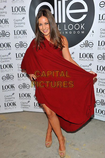 Louise Thompson.The final of the Elite Model Look 2012 competition, a nationwide search to find the supermodels of the future, P3, 35 Marylebone Road, London, England..August 30th, 2012.full length red maroon one shoulder holding skirts  dress beige peep toe shoes.CAP/CJ.©Chris Joseph/Capital Pictures.